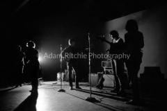 V34-2-27 Edie Sedgewick, Gerard Malanga dancing and Lou Reed, Sterling Morrison and John Cale on bass