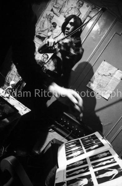 V22-4-15 Piero Heliczer's arm and John Cale