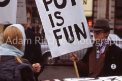Pot is Fun Rally Peter Whelan (?) with poster. Piccadilly Circus 1967
