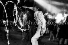 """AR97-1-12 """"Sparkler Man"""" at the I.T. Launch, Roundhouse. This is a one second hand-held photo with a flash from someone else's camera"""