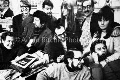 International Times Staff in Indica basement, Summer 1966. L-R: Jeff Nuttall, Miles, Jim Haynes, Peter Stansill, Tom McGrath, Sue Miles, Jack Henry Moore, Roger Whelan,David Z Mairowitz, Hoppy on phone and (?)